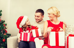 Happy family opening gift boxes Royalty Free Stock Photos
