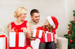 Happy family opening gift boxes Royalty Free Stock Image