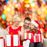 Happy family opening gift boxes Stock Photography