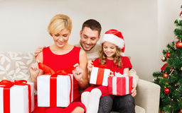 Happy family opening gift boxes Royalty Free Stock Photo