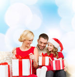 Happy family opening gift boxes Stock Images