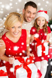 Happy family opening gift boxes Stock Image