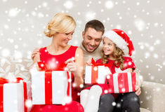 Happy family opening gift boxes Royalty Free Stock Images