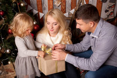 Happy family opening gifts. Royalty Free Stock Photos