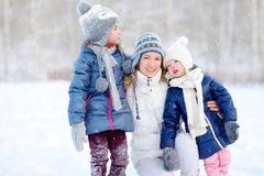 Happy family ot three having fun at winter Stock Photos