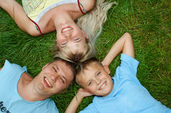 Happy family outdoor. Happy family lie on green grass Stock Photo