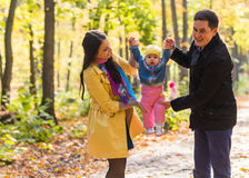 Happy family outdoor in autumn Stock Image