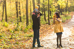 Happy family outdoor in autumn Royalty Free Stock Photos