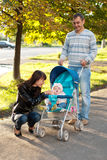 Happy family outdoor with carriage Royalty Free Stock Image