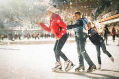 Free Happy Family Outdoor Ice Skating At Rink. Winter Activities Stock Photos - 102055813