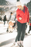 Happy family outdoor ice skating at rink. Winter activities Stock Images