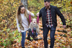 Happy family outdoor in park at autumn. Royalty Free Stock Photo
