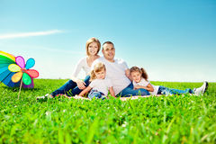 Happy family in outdoor park  at sunny day. Mom, dad and two dau Royalty Free Stock Image