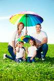 Happy family in outdoor park  at sunny day. Mom, dad and two dau Royalty Free Stock Images