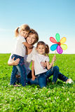 Happy family in outdoor park  at sunny day. Mom and two daughter Royalty Free Stock Photography