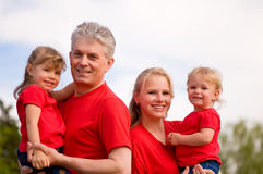 Happy family outdoor in red Stock Photos