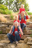 Happy family outdoor in red above each other Royalty Free Stock Image