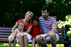 Happy family outdoor smiling at camera Royalty Free Stock Images