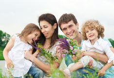 Happy family outdoors Stock Photos