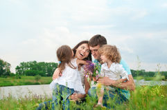 Happy family outdoors Royalty Free Stock Photos
