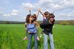 Happy family outdoors on green field Stock Images