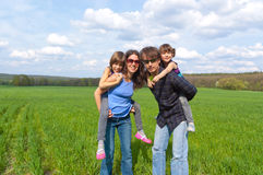 Happy family outdoors having fun stock images