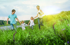 Happy family outdoors royalty free stock photography