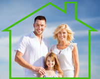 Happy family outdoors. Home, happiness and real estate concept - happy family over blue sky background and house shaped illustration Royalty Free Stock Image