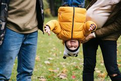 Happy family outdoors. Mother, father and baby on autumn walk in the park stock photo