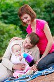 Happy family outdoors portrait Stock Photography