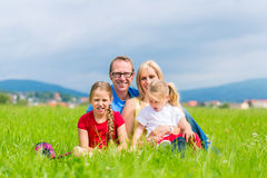 Happy Family outdoors sitting on grass Stock Images