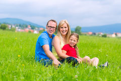 Happy Family outdoors sitting on grass Stock Photography