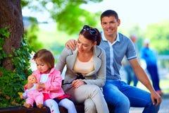 Happy family outdoors Stock Photos
