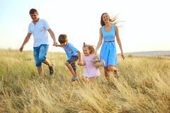 Happy family outdoors walking and smiling. Happy family outdoors walking and smiling in the summer autumn stock photo