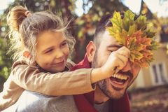 Happy family outside in colorful fall backyard. royalty free stock photos