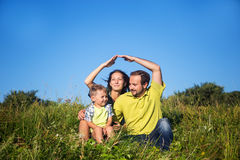 Happy family outside the home Royalty Free Stock Photos