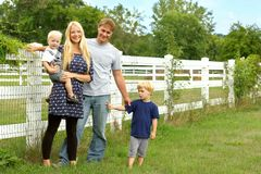 Happy Family Outside by Horse Pasture Stock Images