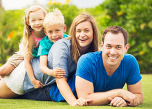 Happy Family Outside Stock Images