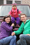 Happy family in outwear near car Stock Photo