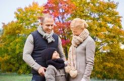 Happy family over autumn park background stock photo