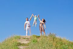 Happy family over blue sky Royalty Free Stock Image