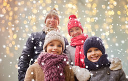 Happy family over christmas lights and snow Royalty Free Stock Photography