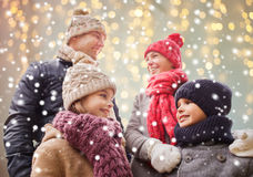 Happy family over christmas lights and snow Royalty Free Stock Photos