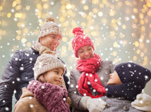 Happy family over christmas lights and snow Royalty Free Stock Images