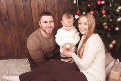 Happy family over christmas tree Royalty Free Stock Photos