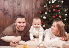 Happy family over christmas tree Stock Photo