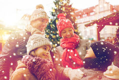 Happy family over city christmas tree and snow Royalty Free Stock Photo