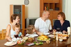 Happy family over dining table Stock Photos