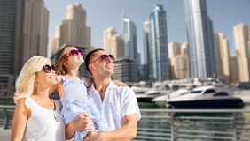 Happy family over dubai city street background Royalty Free Stock Images