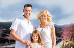 Happy family over hills background Royalty Free Stock Photo